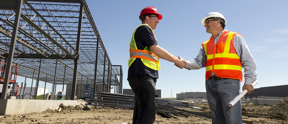 two builders shaking hands
