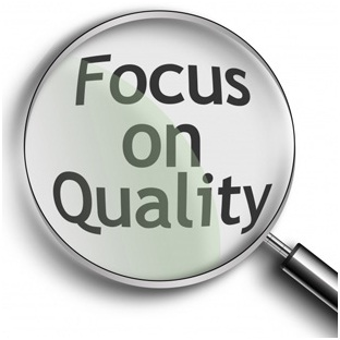 magnifying glass with focus on quality under it