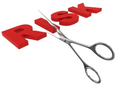 scissors cutting the word risk